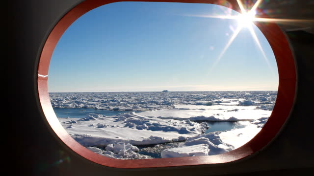 Ice covered ocean through port hole, Antarctica