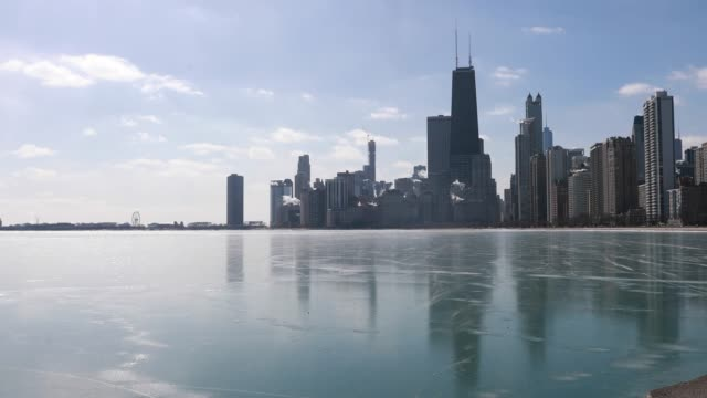 ice covers lake michigan seen from oak street beach with the chicago skyline in the background monday march 2019 monday was first time in over 75... - great lakes stock videos & royalty-free footage