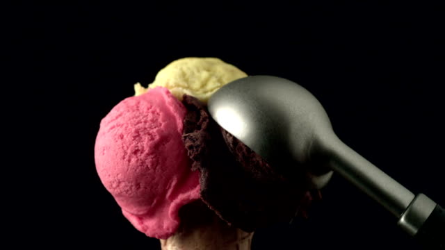 ice cream scoop placing on cornet - ice cream cone stock videos & royalty-free footage