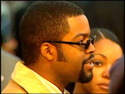 ice cube at the 'anaconda' premiere at the mann village theatre in westwood california on march 15 1997 - レジェンシービレッジシアター点の映像素材/bロール