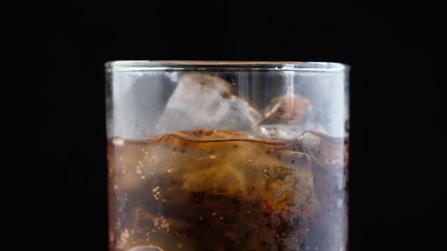 ice cube in fizzy splashing water with soda bubble - rubbing alcohol stock videos & royalty-free footage