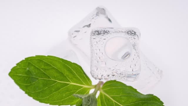 ice cube over white background - mint leaf culinary stock videos and b-roll footage