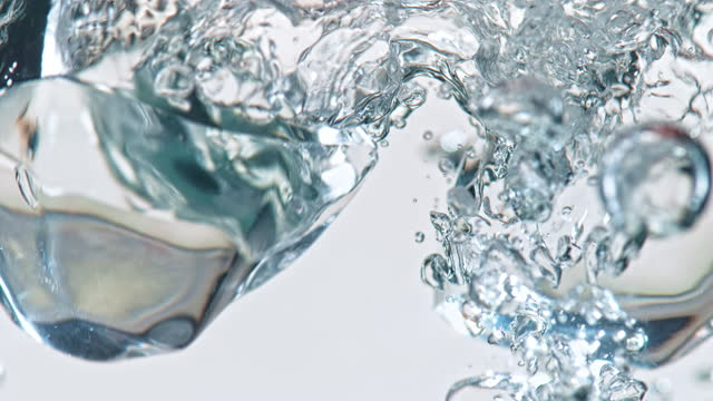 slo mo ld ice cubes falling into water - translucent stock videos & royalty-free footage