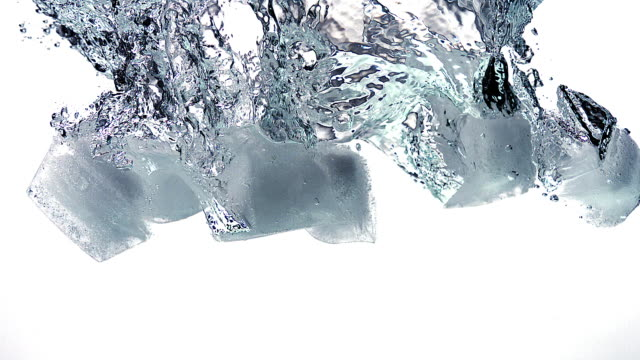 CU SLO MO Ice cubes falling into Water / Vieux Pont, Normandy, France