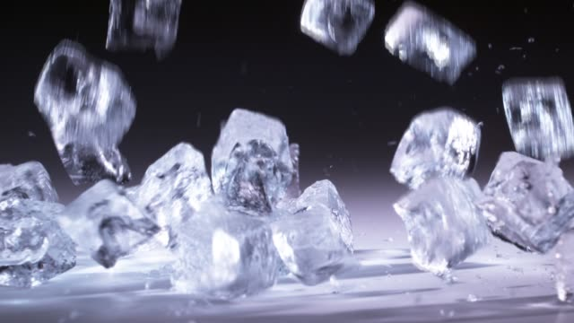 ice cubes falling / south korea - crushed ice stock videos & royalty-free footage