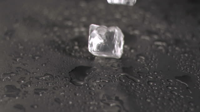 Ice cubes hitting ground in super slow motion
