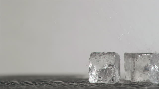 Ice cubes in super slow motion melting