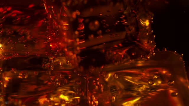 ice cubes in the glass of whiskey and soda - liquor store stock videos and b-roll footage