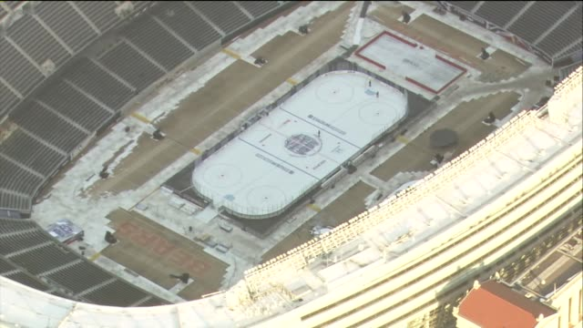ice down at soldier field for a nhl hockey game between the chicago blackhawks and pittsburgh penguins - field hockey stock videos and b-roll footage