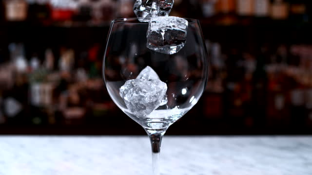 ice falling into wine glass - single object stock videos & royalty-free footage
