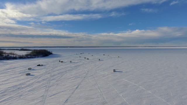 ice fishing scenes - shack stock videos and b-roll footage