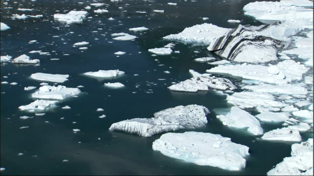 ice floats in a bay near columbia glacier alaska. available in hd. - columbia glacier stock videos & royalty-free footage