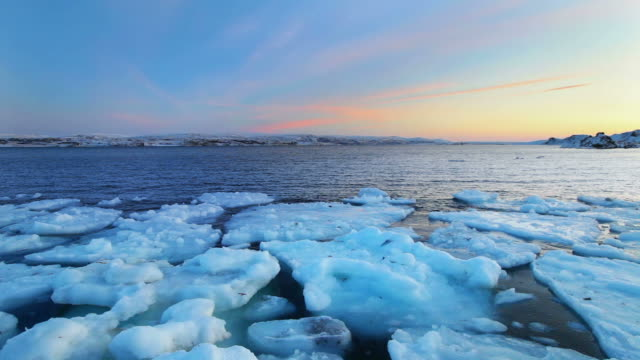 Ice floes at sunset, Arctic Ocean, Porsanger Fjord, Norway