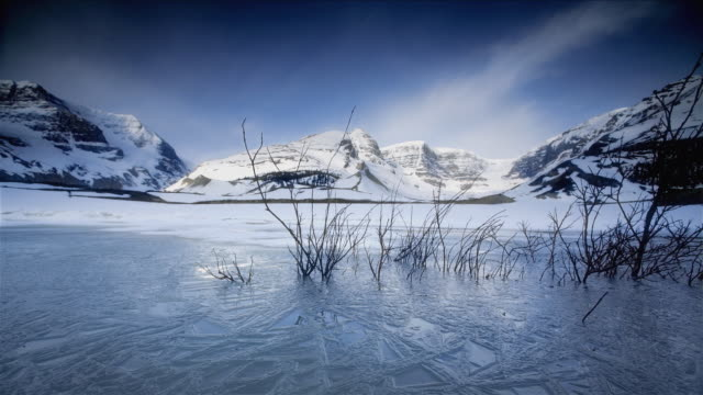 t/l ws pov ice forming on frozen lake in banff national park / banff, alberta, canada - banff national park stock videos & royalty-free footage