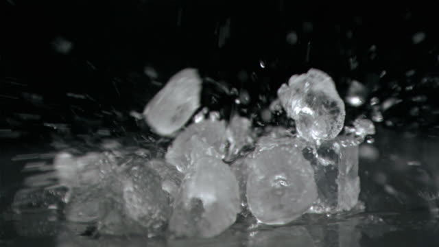 Ice hitting in super slow motion ice cubes