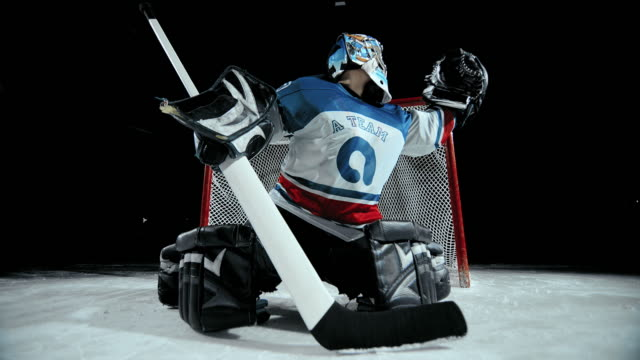 slo mo ds ice hockey goaltender catching the puck - hockey glove stock videos & royalty-free footage
