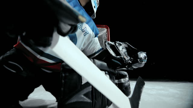 SLO MO DS Ice hockey goaltender fails to stop the flying puck