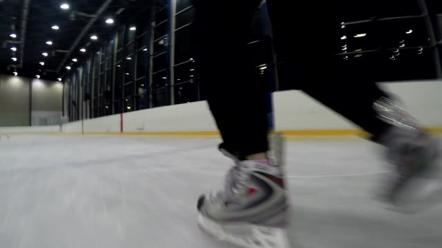 ice hockey - moving with puck - ice rink stock videos & royalty-free footage
