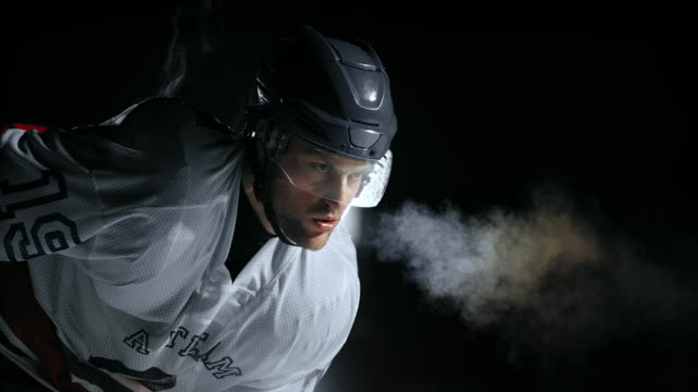 SLO MO Ice hockey player breathing out