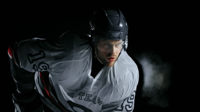 SLO MO Ice hockey player focusing on the game