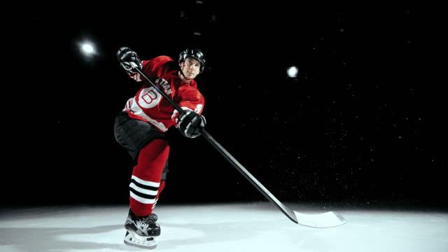 SLO MO LD Ice hockey player hitting the puck