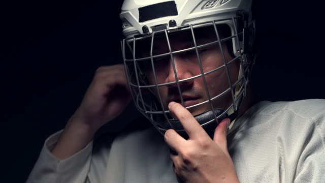 ice hockey player in the mask, one lighting in dark room. - hockey glove stock videos & royalty-free footage