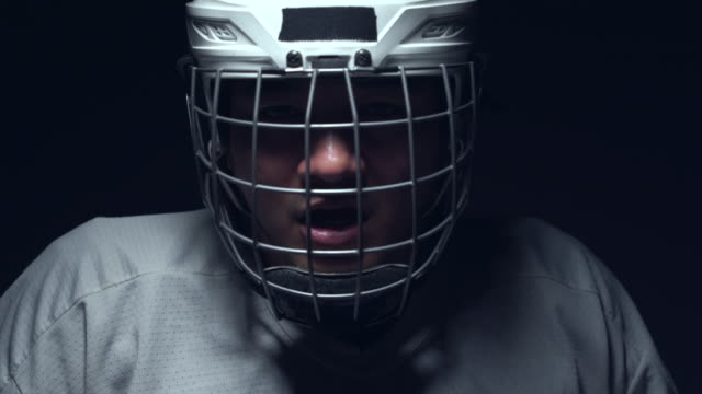 ice hockey player is be tired in the mask, one lighting in dark room. - hockey glove stock videos & royalty-free footage