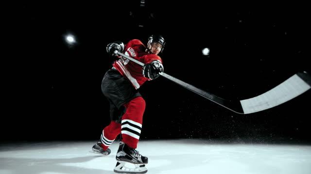 slo mo ld ice hockey player making a shot - アイスホッケー点の映像素材/bロール