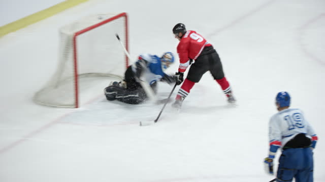 Ice hockey player scores a goal