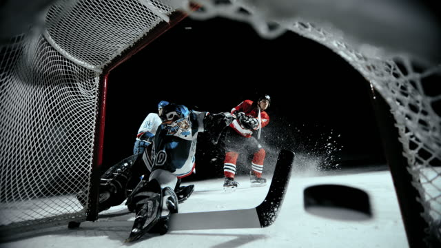 slo mo ice hockey player scoring a goal - winter sport stock videos and b-roll footage