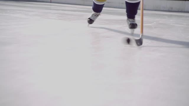 MS TS Ice hockey player stick handling as he skates toward camera/ Long Island, NY