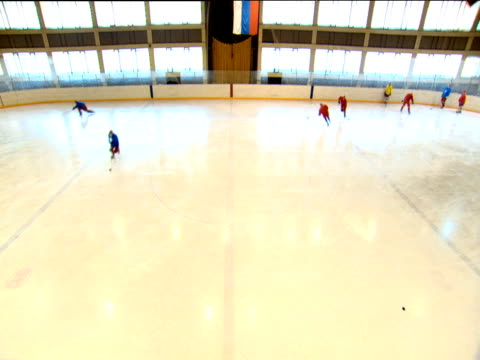 Ice hockey players skate around ice rink during training session Moscow