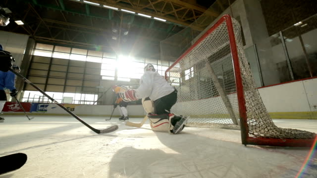 ice hockey players tackling and scoring during sports match in a rink. - tackling stock videos and b-roll footage