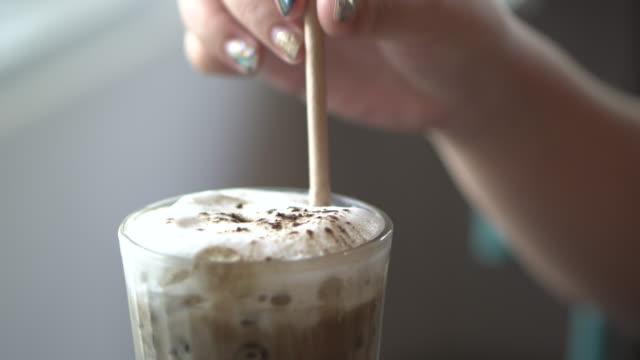 ice hojicha latte and close-up woman hand - milkshake stock videos & royalty-free footage