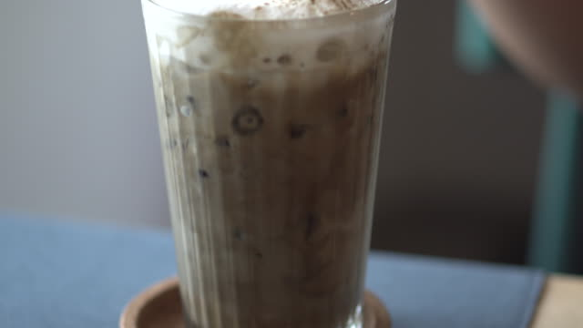 ice hojicha latte and close-up woman hand - mocha stock videos and b-roll footage