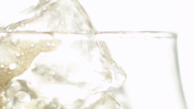 Ice in glass of cola drink