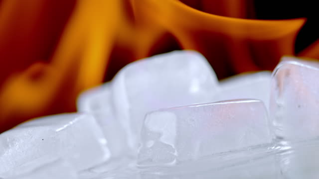 slo mo ld ice melting in fire flames - contrasts stock videos & royalty-free footage