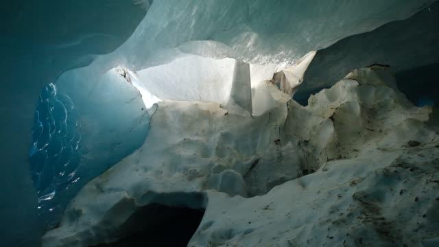 ice melts inside the ice of the rhone glacier on august 19 2019 near obergoms switzerland the rhone glacier is the source of the rhone river and... - アトモスフィア点の映像素材/bロール