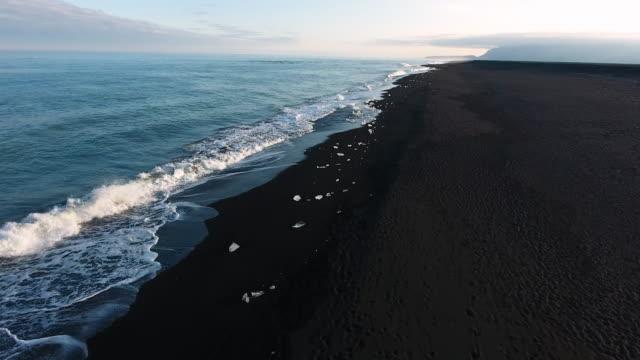 ice on diamond beach in iceland - black sand stock videos & royalty-free footage