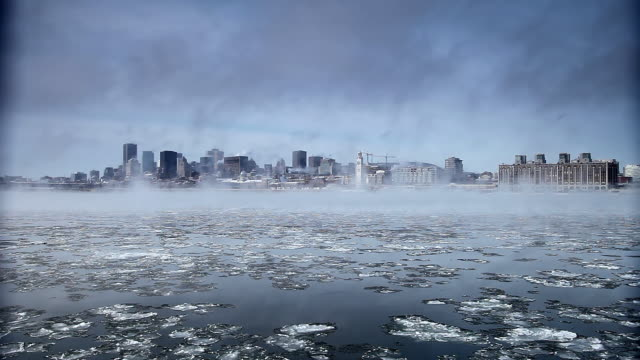 Ice on Saint Lawrence River in front of the city of Montreal. There's a lot of smoke and it's really cold