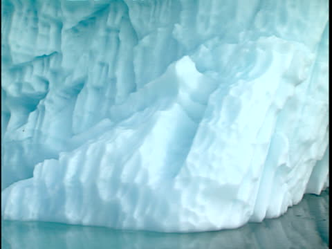 cu pan ice patterns created by wind and water erosion as icebergs drift and melt, baffin bay, canada - eroded stock videos & royalty-free footage