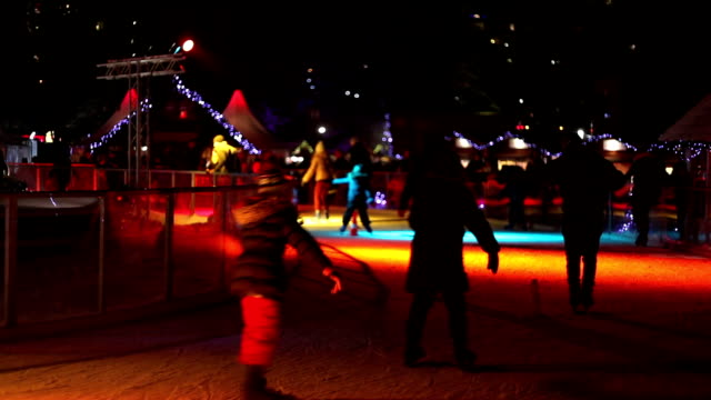 ice rink at christmas market - ice rink stock videos & royalty-free footage