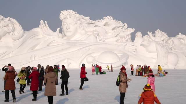 ice sculptures at the harbin ice and snow festival in heilongjiang province, harbin, china - human representation stock videos & royalty-free footage