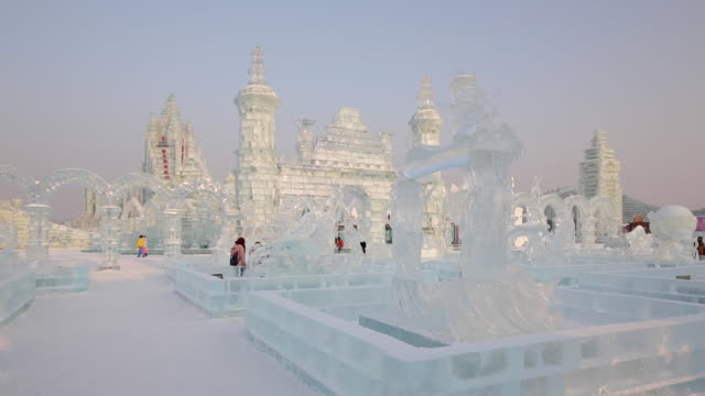 ice sculptures at the harbin ice and snow festival in heilongjiang province, harbin, china - schneefestival stock-videos und b-roll-filmmaterial
