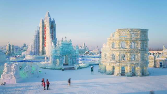 ice sculptures at the harbin ice and snow festival in heilongjiang province, harbin, china - time lapse - schneefestival stock-videos und b-roll-filmmaterial