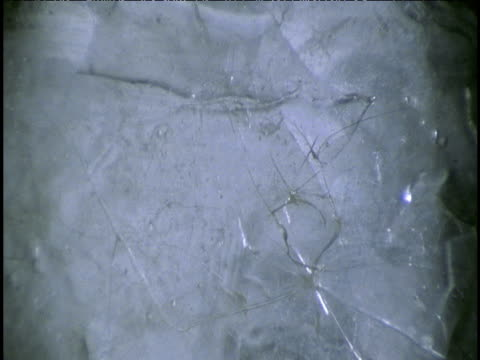 Ice sheet gradually develops cracks all over its surface