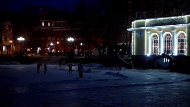 Ice skaters at rink