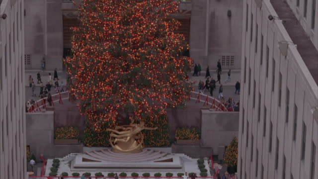 ice skaters skate in front of the christmas tree at rockefeller center. - rockefeller center christmas tree stock videos & royalty-free footage
