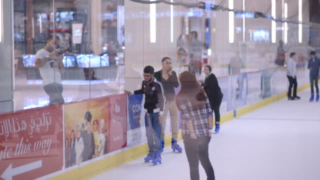 ice skating in dubai mall - ice rink stock videos & royalty-free footage