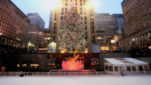 ws ice skating rink below rockerfeller centre building / new york, united states - rockefeller center video stock e b–roll